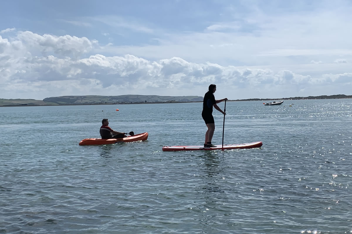 Paddle boarding on the river Dovey at Aberdovey